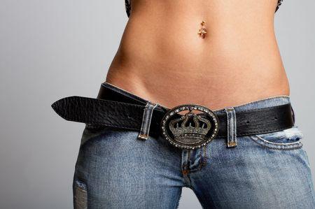 beautiful navel women: Sexy tanned woman belly shot in studio