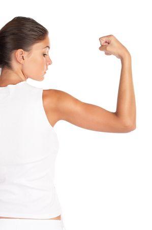 strong arm: Beautiful woman flexing biceps - high key shot in studio