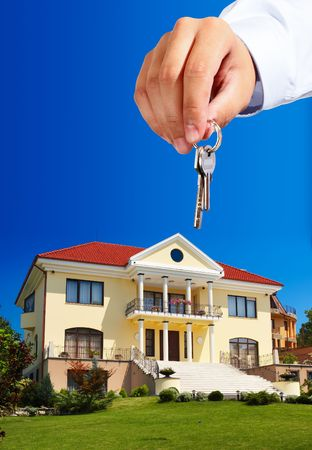 economic rent: House ownerreal estate agent giving away the keys - everything in focus Stock Photo