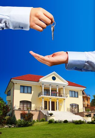 House ownerreal estate agent giving away the keys - everything in focus photo