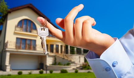 possibility: House ownerreal estate agent giving away the keys - house out of focus
