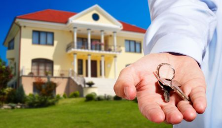 House ownerreal estate agent giving away the keys - house out of focus photo