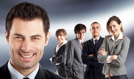 Entrepreneur - with his team behind him - people in the background are all in focus Stock Photo - 1686107