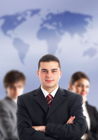 Leader and his team - Young attractive business people with world map in background - focus only on businessman in the middle photo