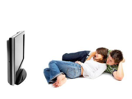 pareja viendo tv: Junte TV que mira - vista lateral - aislada en blanco