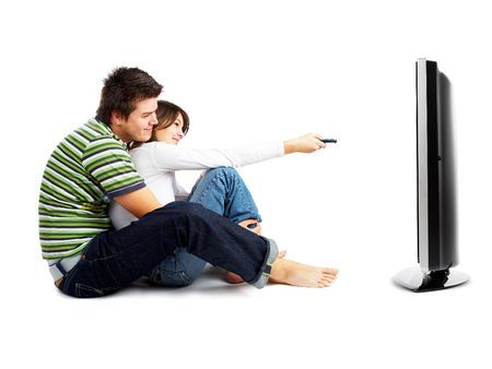 tv watching: Couple watching TV - side view - isolated on white