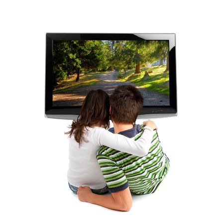 Couple watching TV - rear view - isolated on white