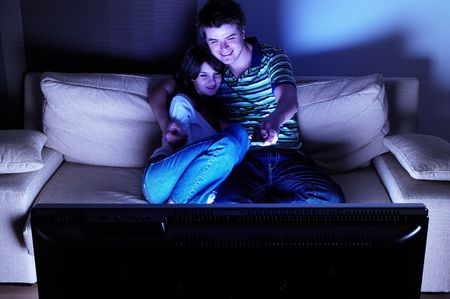 Couple on couch watching TV - having a great time Stock Photo - 2038071