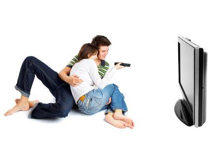 pareja viendo tv: La pareja viendo la televisi�n - la vista lateral - aislados en blanco
