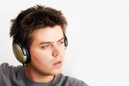Young Man listening music in headphones photo
