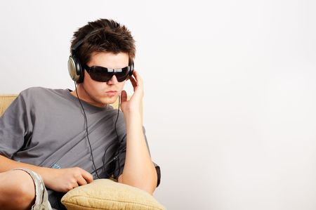 Young Man listening music in headphones Stock Photo - 2096574