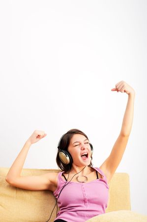 Young Girl enjoys listening music in headphones photo