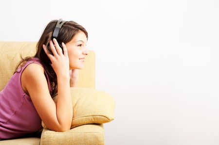 Young Girl enjoys listening music in headphones Banque d'images