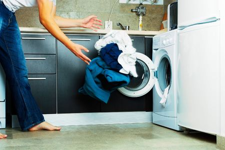 conformity: Concept Man throwing his laundry into the washing machine