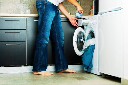 dirty clothes: Concept Man putting detergent into the washing machine Stock Photo