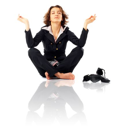 Businesswoman with legs crossed meditating Stock Photo