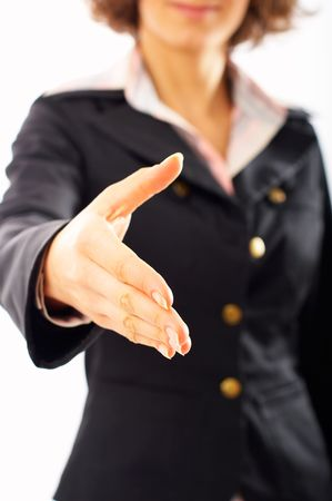 Close-up of woman ready for handshake. Shallow depth of field