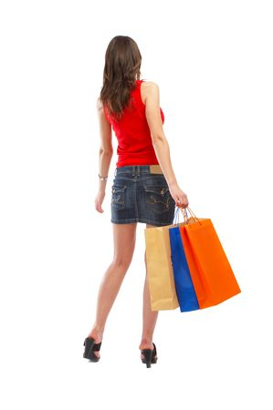 Beautiful woman with casual outfit and shopping bags in her hands over white background