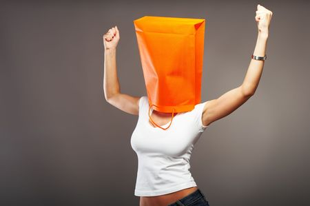 sihlouette: Shopping metaphor, woman with shopping bag over her head