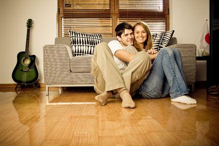 Happy young couple having fun on the sofa Stock Photo