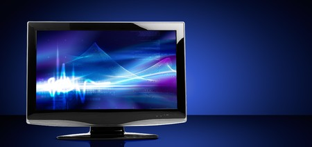 LCD television set on reflective table Stock Photo