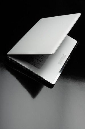 Laptop shot on reflective table  Stock Photo - 4192659