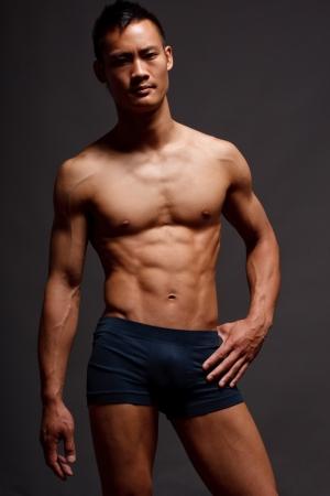 boy underwear: Male Fashion shot, muscular asian guy Stock Photo
