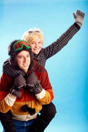 Happy young couple having fun winter themed image photo