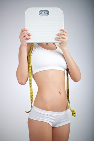 Woman with bathroom scale and measuring tape Stock Photo - 4373718