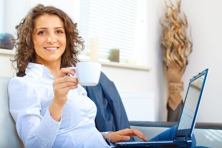 Business woman at home using laptop Stock Photo