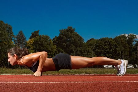 Athletic woman working out on track Stock Photo - 5443094