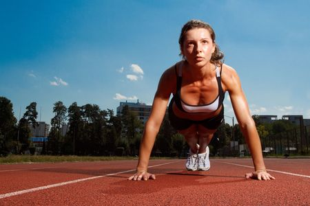 Athletic woman working out on track Banque d'images