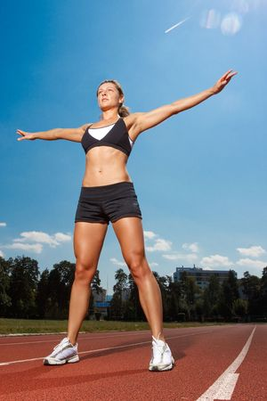 Athletic woman working out on track photo