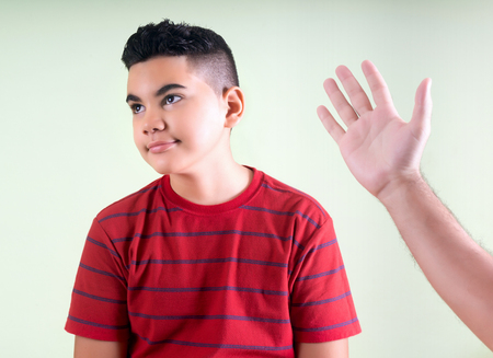 Naughty boy threatened by his father