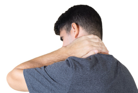 A man with a persistent pain on the neck isolated on white Stock Photo