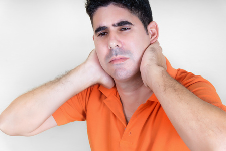 A man with a persistent pain on the neck Stock Photo