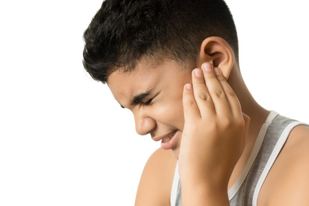 Boy has earache isolated on white