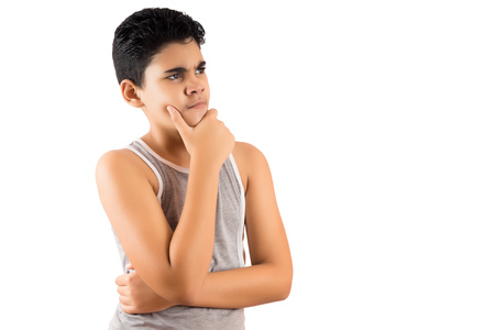 Young latin boy in a pensive pose isolated on white Stock Photo