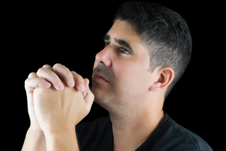 He pray to God isolated on black Stock Photo