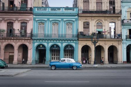 HAVANA, CUBA-DECEMBER 5, 2017 : Urban scene with old buildings and a classic american car in Old Havana