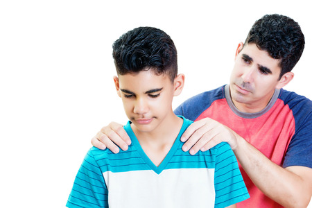 Latin father comfort to his teenager son isolated on white Imagens