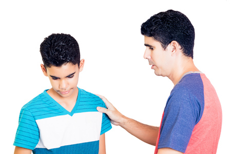 Latin father comfort to his teenager son isolated on white Stock Photo
