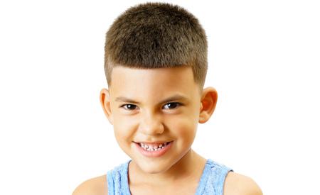 Playful little kid isolated on white. Stock Photo