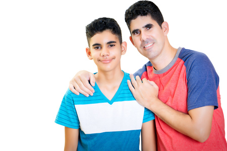 Latin father and his teenager son isolated on white