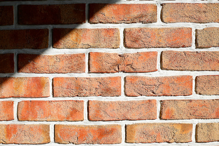 The brick wall of the cracked decorative brick is red .Texture.Background.