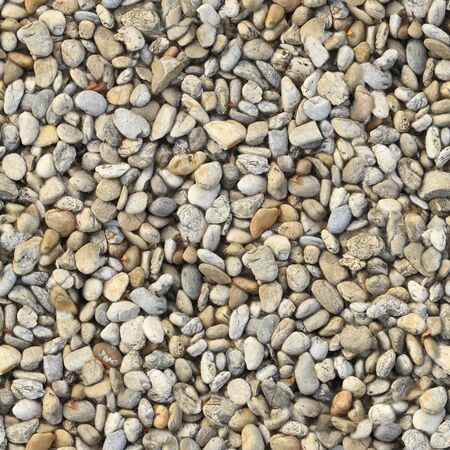 Large pebbles of different colors on the lake .Texture or background