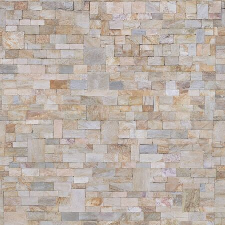 Tiles on the wall are made of different pieces .Background or texture