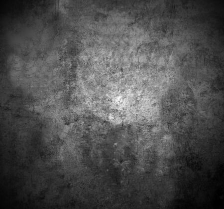 The scratched textured surface of the concrete wall is grey . Texture or background. 版權商用圖片
