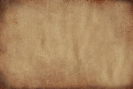 Parchment paper aged by time with burnt edges of yellow color.Texture or background