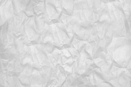 Crumpled sheet of white paper square shape.Texture or background
